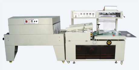 Automatic L sealing and cutting heat shrinkable film packaging machine